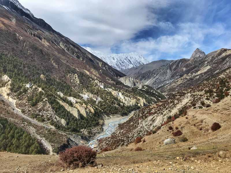 Short treks in Nepal with river flowing mountain landscape