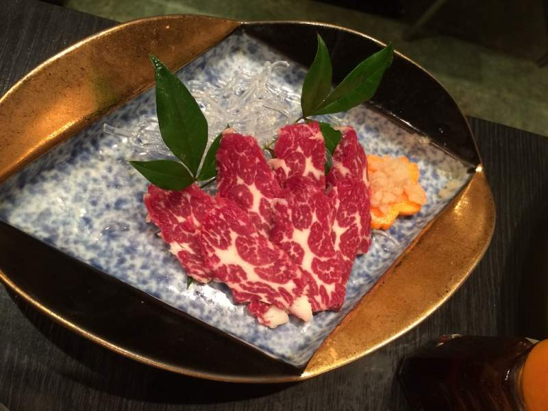 Eating Basashi Raw Horse meat Japan weird exotic food