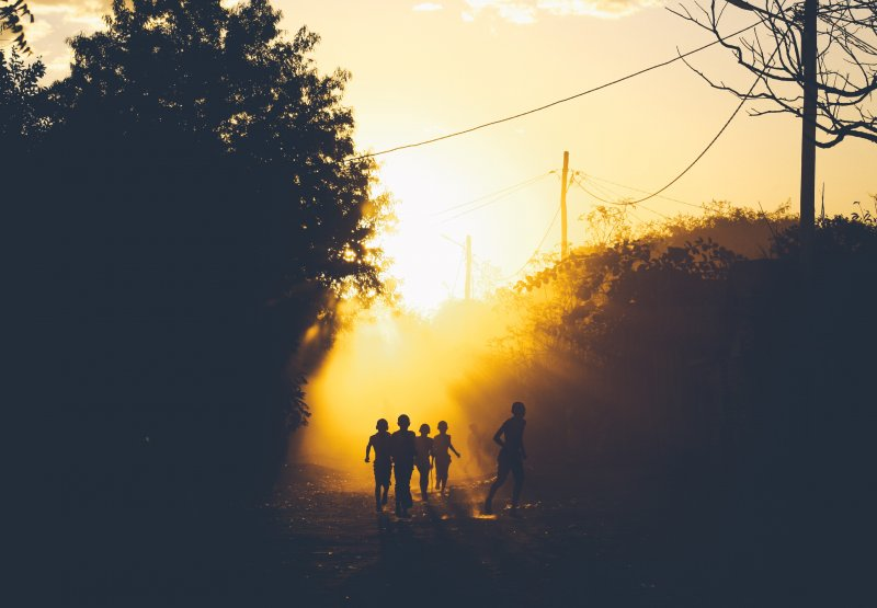 Children playing during beautiful African sunset